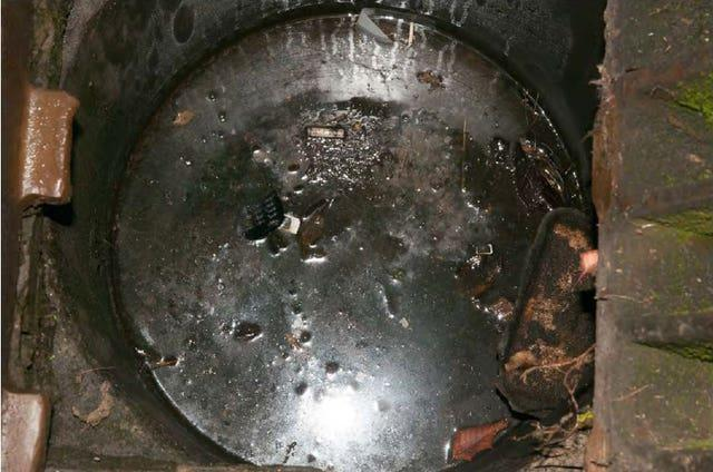 Maurice Robinson's mobile phone in a drain (Essex Police/PA)