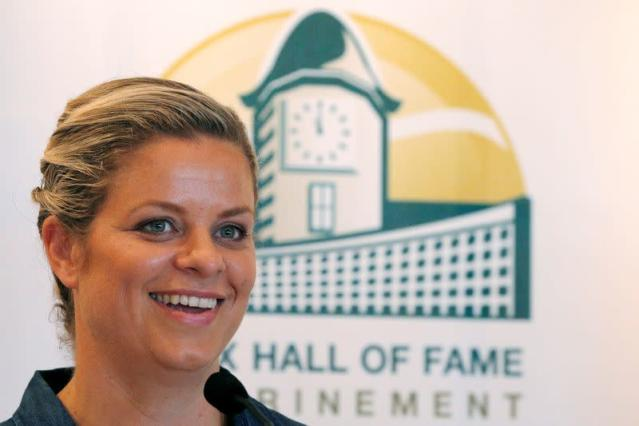 FILE PHOTO: Kim Clijsters of Belgium smiles during a news conference before being inducted into the International Tennis Hall of Fame in Newport