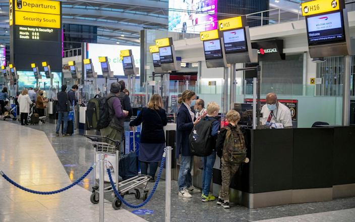 People at the bag drop at Heathrow terminal five, as flights reopen to green-list countries - Geoff Pugh for The Telegraph
