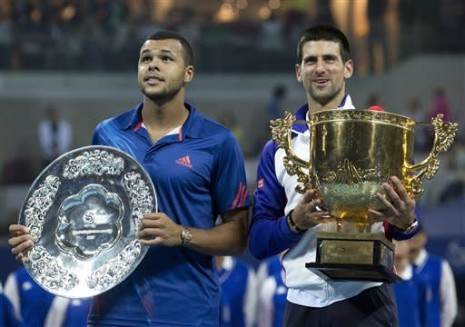 Serbia's Novak Djokovic, right, and Jo-Wilfried Tsonga of France pose after their men's singles final match in the China Open tennis tournament in Beijing Sunday, Oct. 7, 2012. Djokovic defeated Tsonga 7-6, 6-2. (AP Photo/Andy Wong)