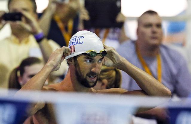 Michael Phelps prepares to swim in a 200-meter freestyle, preliminary event at the Arena Grand Prix swim meet in Charlotte, N.C., Friday, May 16, 2014. (AP Photo/Nell Redmond)