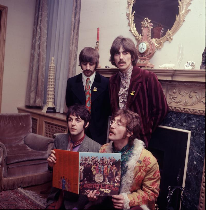 The Beatles pose for the press with their newly completed album, 'Sergeant Pepper's Lonely Hearts Club Band', at the press launch for the album, held at manager Brian Epstein's house at 24 Chapel Street, London, 19th May 1967. Clockwise from top left: Ringo Starr, George Harrison (1943 - 2001), John Lennon (1940 - 1980) and Paul McCartney. (Photo by Mark and Colleen Hayward/Getty Images)