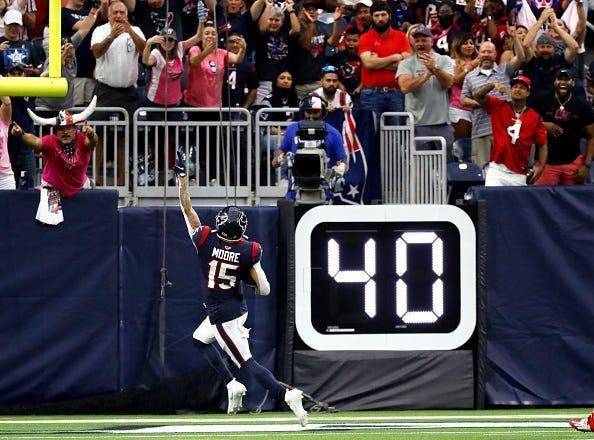 The Houston Texans' Chris Moore celebrates a touchdown during the first half against the New England Patriots.