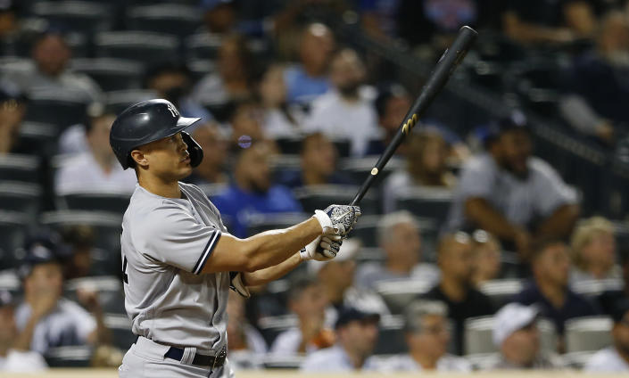 New York Yankees' Giancarlo Stanton watches his two-run home run against the New York Mets during the seventh inning of a baseball game, Sunday, Sept. 12, 2021, in New York. (AP Photo/Noah K. Murray)