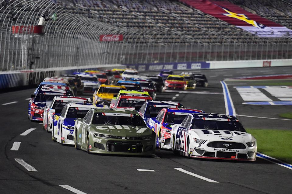 Brad Keselowski (2) and Jimmie Johnson (48) lead the field on an overtime restart during the 2020 Coca-Cola 600 at Charlotte Motor Speedway.