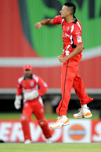 PRETORIA, SOUTH AFRICA - OCTOBER 10: Rayad Emrit of Trinidad & Tobago celebrates the wicket of Adam Lyth of Yorkshire during the Karbonn Smart CLT20 pre-tournament Qualifying Stage match between Yorkshire (England) and Trinidad and Tobago (West Indies) at SuperSport Park on October 10, 2012 in Pretoria, South Africa.  (Photo by Lee Warren / Gallo Images / Getty Images)