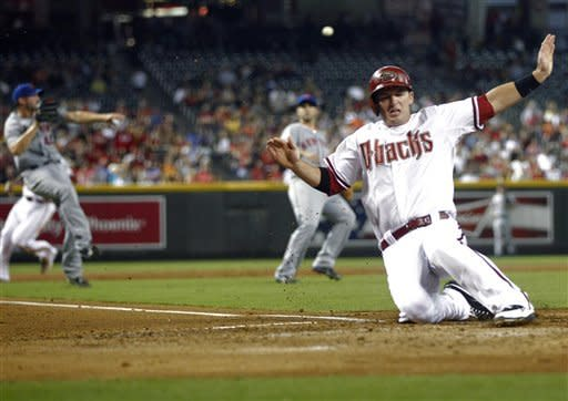 Arizona Diamondbacks' Stephen Drew scores on a base hit by Willie Bloomquist during the second inning of a baseball game against the New York Mets, Friday, July 27, 2012, in Phoenix. (AP Photo/Matt York)