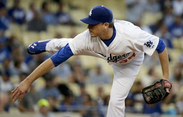 Los Angeles Dodgers starting pitcher Kevin Correia throws to the San Diego Padres during first inning of a baseball game in Los Angeles, Tuesday, Aug. 19, 2014. (AP Photo/Chris Carlson)