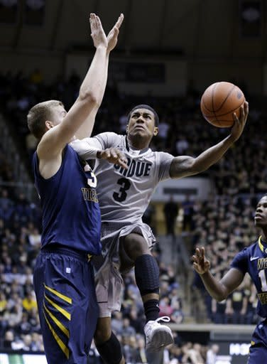 Purdue guard Ronnie Johnson, right, shoots over West Virginia forward Volodymyr Gerun during the second half of an NCAA college basketball game in West Lafayette, Ind., Saturday, Jan. 19, 2013. Purdue defeated West Virginia 79-52. (AP Photo/Michael Conroy)