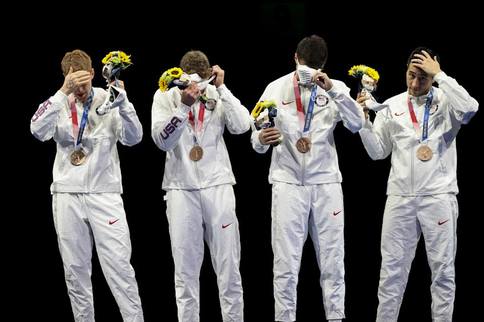 Race Imboden (far left) offers a silent protest during the medal ceremony. (Molly Darlington/Reuters)