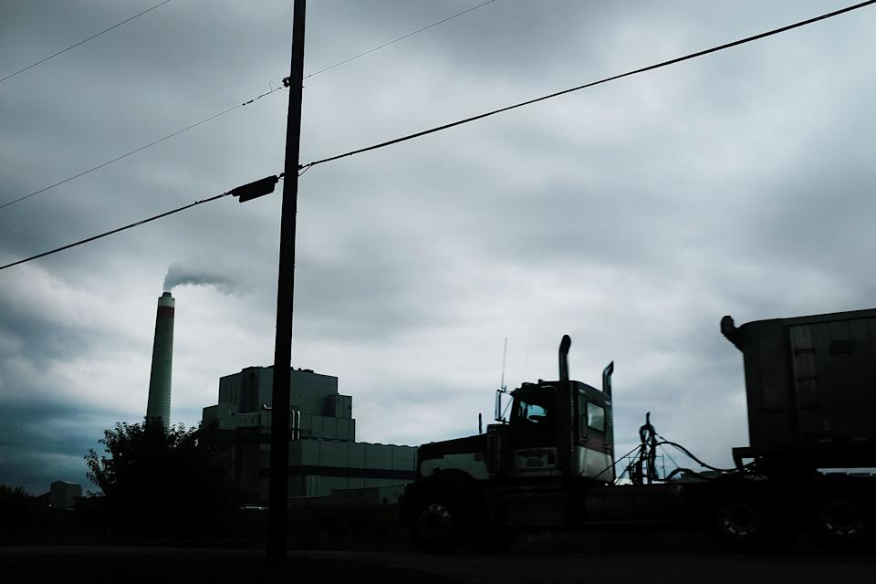 MAIDSVILLE, WV - AUGUST 21:  A truck drives by the Longview Power Plant,  a coal-fired plant, stands on August 21, 2018 in Maidsville, West Virginia. The plant's single unit generates 700 net megawatts of electricity from run-of-mine coal and natural gas. In a stop in West Virginia tonight, President Donald Trump is expected to announce a proposal to allow states to set their own emissions standards for coal-fueled power plants. Environmental activists say this would be a massive blow to reducing carbon emissions.  (Photo by Spencer Platt/Getty Images)