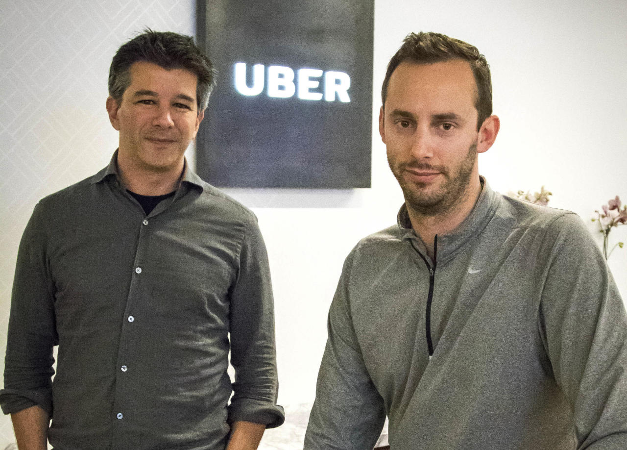 FILE - In this Thursday, Aug. 18, 2016, file photo, then-Uber CEO Travis Kalanick, left, and Anthony Levandowski, co-founder of Otto, pose for a photo in the lobby of Uber headquarters, in San Francisco. In a court filing on Thursday, June 22, 2017, Uber said it hired Levandowski, a former Google engineer now accused of stealing trade secrets, even though the company knew at the time that he had information that didn't belong to him. Uber hired Levandowski in August 2016 to head Uber's project on self-driving cars, something he worked on at Google. Uber is asserting that Kalanick told Levandowski not to bring the material with him and that Levandowski assured the company that he had destroyed the five discs containing Google information. Uber recently fired Levandowski. (AP Photo/Tony Avelar, File)