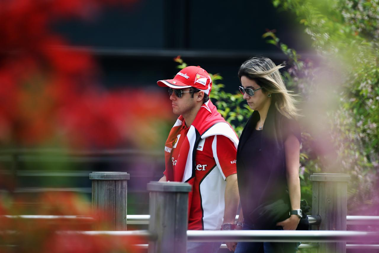 SHANGHAI, CHINA - APRIL 15:  Felipe Massa of Brazil and Ferrari walks in the paddock together with his wife Anna Rafaela Bassi before the Chinese Formula One Grand Prix at the Shanghai International Circuit on April 15, 2012 in Shanghai, China.  (Photo by Clive Mason/Getty Images)