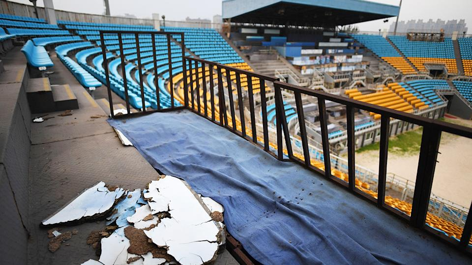 The Olympic beach volleyball stadium lying rotting and disused.