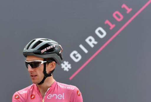 Overall leader Simon Yates of Britain arrives to take the start of the 15th stage of the Giro d'Italia from Tolmezzo to Sappada, Italy, Sunday, May 20, 2018. . (Daniel Dal Zennaro/ANSA via AP)