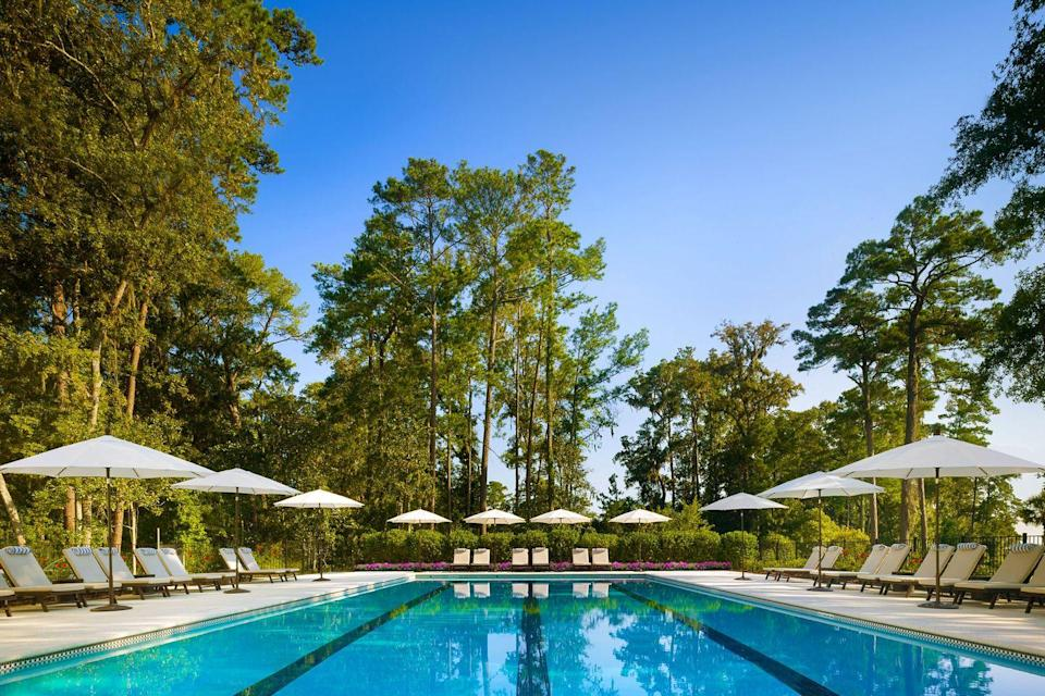 """<p>Your husband may not appreciate a classic Southern retreat that revolves around the pool, curling up with a book, and some needed R&R, but your girls will. Bluffton is an undiscovered low country prize nestled just south of Charleston. At <a href=""""http://www.palmettobluff.com/stay.aspx"""" rel=""""nofollow noopener"""" target=""""_blank"""" data-ylk=""""slk:Montage Palmetto Bluff"""" class=""""link rapid-noclick-resp""""><u>Montage Palmetto Bluff</u></a>, try boating or horseback riding on a 20,000-acre property that also offers a full-service spa complete with a salon, movement studio, and boutique. Splurge on some shopping and spa treatments with your friends, embark on a freshwater or saltwater kayaking adventure, or test your skills on the golf course. And since this is a just-girls vacation, you'll also want to be sure to book a roomy <a href=""""https://www.montagehotels.com/palmettobluff/accommodation/river-view-cottage/"""" rel=""""nofollow noopener"""" target=""""_blank"""" data-ylk=""""slk:cottage with a river view"""" class=""""link rapid-noclick-resp""""><u>cottage with a river view</u></a> and spend way too much time on your screened in porch, disconnecting from reality.</p><p><strong><em>For more information, visit </em></strong><a href=""""https://www.montagehotels.com/palmettobluff/"""" rel=""""nofollow noopener"""" target=""""_blank"""" data-ylk=""""slk:montagehotels.com/palmettobluff"""" class=""""link rapid-noclick-resp""""><strong><em>montagehotels.com/palmettobluff</em></strong></a><strong><em>.</em></strong></p>"""