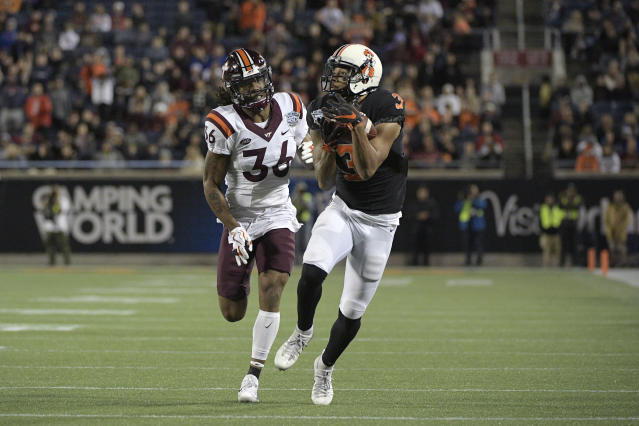 "Oklahoma State wide receiver <a class=""link rapid-noclick-resp"" href=""/nfl/players/31198/"" data-ylk=""slk:Marcell Ateman"">Marcell Ateman</a> (3) runs after catching a pass in front of Virginia Tech cornerback <a class=""link rapid-noclick-resp"" href=""/ncaaf/players/252232/"" data-ylk=""slk:Adonis Alexander"">Adonis Alexander</a> (36) during the first half of the Camping World Bowl NCAA college football game Thursday, Dec. 28, 2017, in Orlando, Fla. (AP Photo/Phelan M. Ebenhack)"