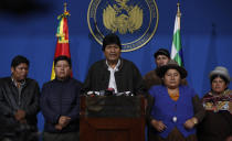 Bolivia's President Evo Morales, center, speaks during a press conference at the military base in El Alto, Bolivia, Sunday, Nov. 10, 2019. Hours later Morales announced his resignation under mounting pressure from the military and the public after his re-election victory triggered weeks of fraud allegations and deadly protests. (AP Photo/Juan Karita)