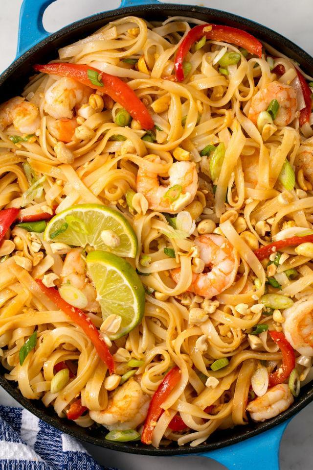 """<p>Save the takeout guy a trip and make this instead.</p><p>Get the recipe from <a href=""""http://www.delish.com/cooking/recipe-ideas/recipes/a53823/easy-pad-thai-recipe/"""" rel=""""nofollow noopener"""" target=""""_blank"""" data-ylk=""""slk:Delish"""" class=""""link rapid-noclick-resp"""">Delish</a>.</p><p><em><strong>UP YOUR SKILLET GAME: Le Creuset Cast-Iron 12"""" Skillet, $200; </strong></em><a href=""""https://www.amazon.com/Creuset-Signature-Handle-Skillet-4-Inch/dp/B00B4UOTBQ/?tag=syndication-20"""" rel=""""nofollow noopener"""" target=""""_blank"""" data-ylk=""""slk:amazon.com"""" class=""""link rapid-noclick-resp""""><em><strong>amazon.com</strong></em></a></p>"""