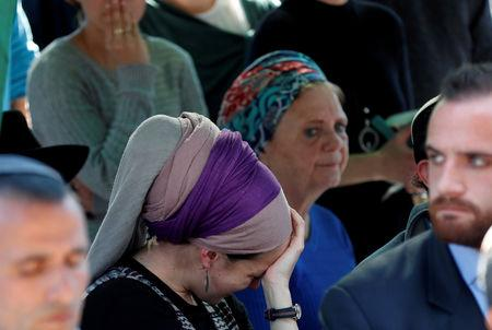 Relatives and friends mourn during the funeral of Israeli rabbi Achiad Ettinger, in the Jewish settlement of Eli in the Israeli-occupied West Bank March 18, 2019. REUTERS/Ronen Zvulun