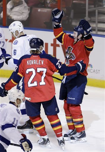 Florida Panthers' Jerred Smithson, right, celebrates with teammate Alex Kovalev (27) after scoring the game tying goal, 3-3, against the Tampa Bay Lightning in the second period of an NHL hockey game in Sunrise, Fla., Saturday, Feb. 16, 2013. (AP Photo/Alan Diaz)