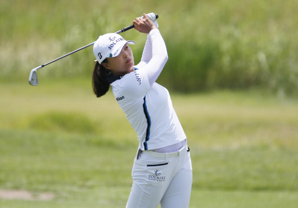 Jin Young Ko, of South Korea, plays her second shot on the first hole during the final round of the LPGA Volunteers of America Classic golf tournament in The Colony, Texas, Sunday, July 4, 2021. (AP Photo/Ray Carlin)
