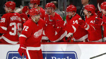 Detroit Red Wings left wing Andreas Athanasiou (72) is congratulated for his goal against the Montreal Canadiens during the third period of an NHL hockey game Tuesday, Feb. 18, 2020, in Detroit. (AP Photo/Paul Sancya)