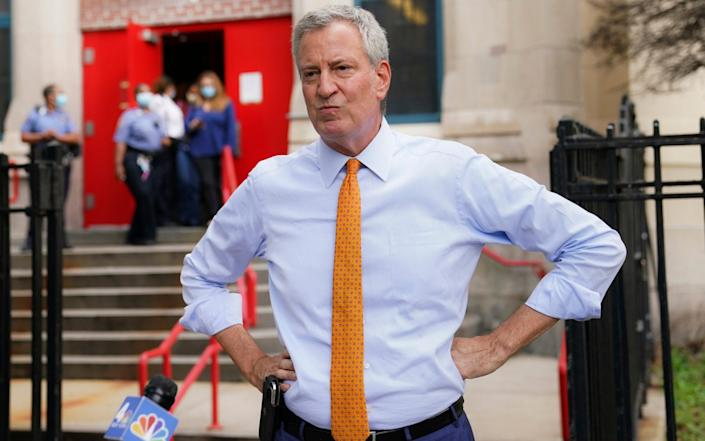 Mr de Blasio announced that all of his staff, including his wife and himself, must take a week of unpaid leave -  John Minchillo  / AP