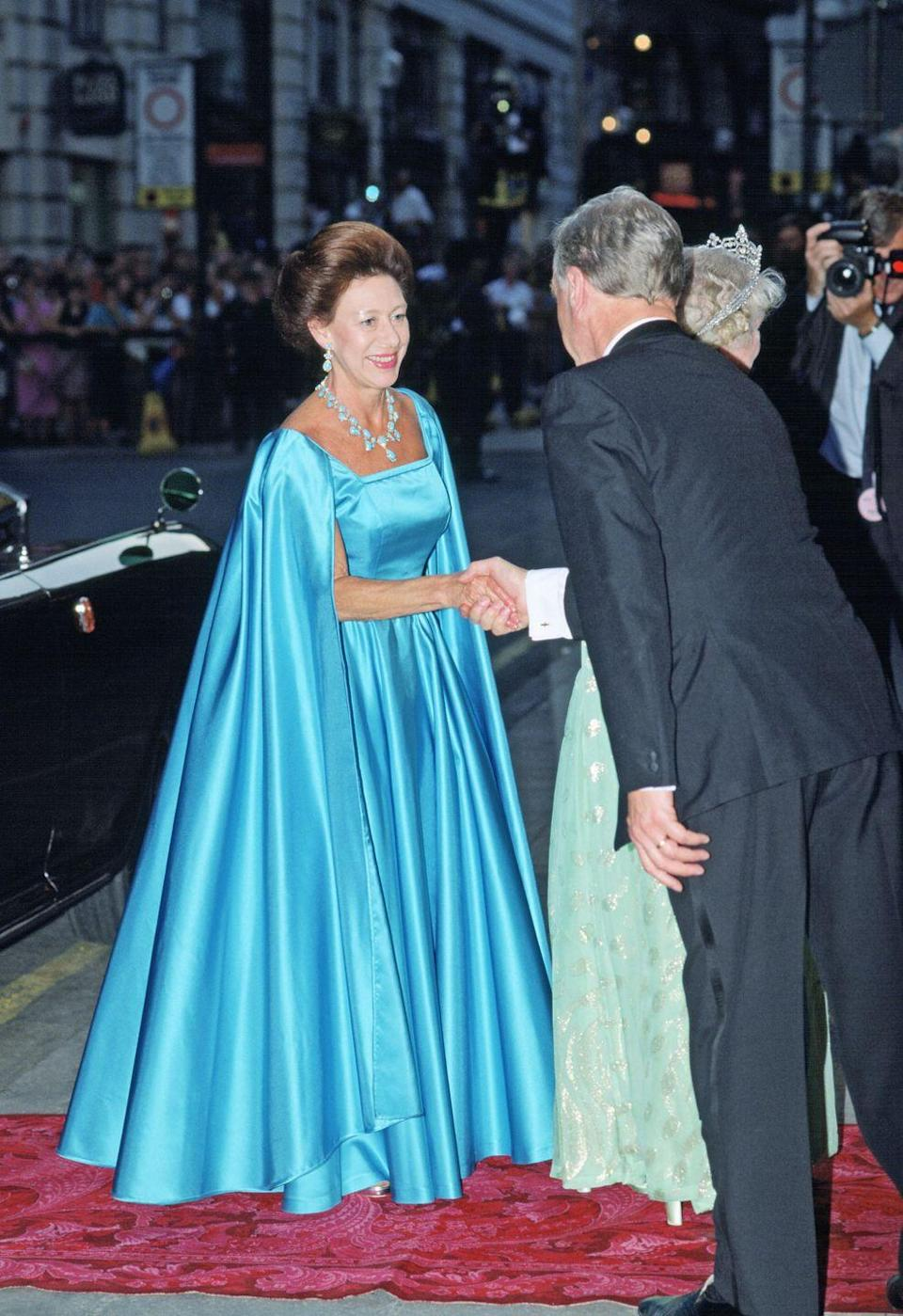 <p>In the summer of 1990, Princess Margaret was on hand to celebrate the Queen Mother's 90th birthday at the London Palladium. She wore this icy-blue number for the occasion, along with a blue necklace and earrings. </p>
