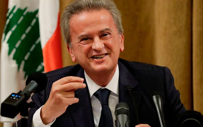Lebanese Central Bank Governor Riad Salameh makes a gesture at a press conference at Beirut's banking headquarters on November 11, 2019