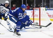 Toronto Maple Leafs defenseman Zach Bogosian (22) clears the puck while playing against the Winnipeg Jets during second period NHL hockey action in Toronto on Monday, Jan. 18, 2021. (Nathan Denette/The Canadian Press via AP)