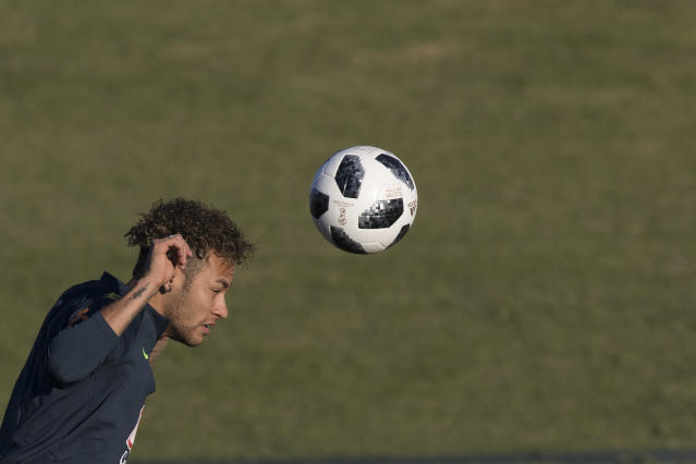 Brazil's Neymar heads the ball during a practice session of the Brazil national soccer team at the Granja Comary training center, in Teresopolis, Brazil, Tuesday, May 22, 2018. (AP Photo/Leo Correa)