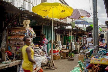Customers peruse goods at Makola market in Accra