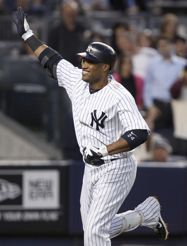 "FILE - In this June 6, 2012 file photo, New York Yankees' Robinson Cano smiles after hitting a solo home run during the fourth inning of a baseball game against the Tampa Bay Rays at Yankee Stadium in New York. The Seattle Mariners say that cannot confirm any details of a potential deal with free agent second baseman Robinson Cano. The team said Friday morning, Dec. 6, 2013, they will announce if an agreement is ""completed and finalized"" with the Yankees star. The statement came in response to an ESPN report Friday morning that Cano and the Mariners had reached agreement on a $240 million, 10-year contract pending a physical.(AP Photo/Seth Wenig, File)"