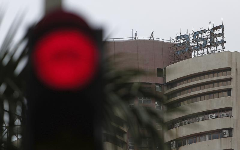 The Bombay Stock Exchange (BSE) building is pictured next to a traffic signal in Mumbai
