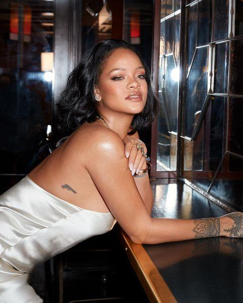 """<p>On the right side of her body Rihanna has a gun tattoo. In a 2013 <a href=""""https://www.elle.com/uk/fashion/news/g4104/rihanna-elle-cover-april-2013-uk/"""" rel=""""nofollow noopener"""" target=""""_blank"""" data-ylk=""""slk:interview with this magazine"""" class=""""link rapid-noclick-resp"""">interview with this magazine</a>, she explained: 'Everybody wanted to know what was happening in my life. """"Is she a drug addict? No. Is she an alcoholic? No. Is she a victim? No."""" That's why I got the gun. It was a symbol of strength. I'll never be a victim.'</p><p><a href=""""https://www.instagram.com/p/B_L2mgmnMZe/"""" rel=""""nofollow noopener"""" target=""""_blank"""" data-ylk=""""slk:See the original post on Instagram"""" class=""""link rapid-noclick-resp"""">See the original post on Instagram</a></p>"""