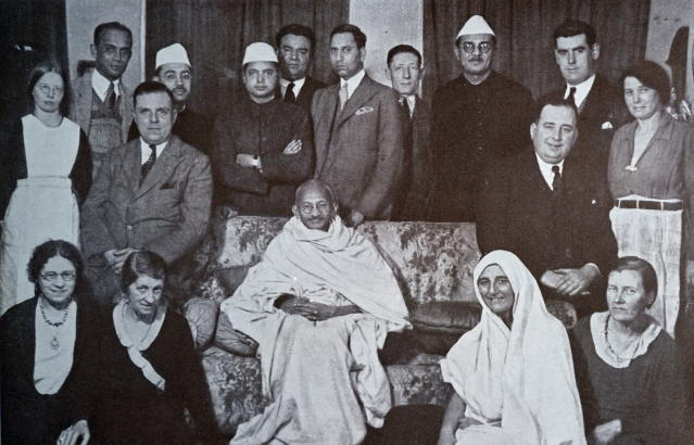 Mahatma Gandhi surrounded by well wishers at a home in London 1931. Seated to his right in a Sari, is his follower Miraben. Mohandas Gandhi (1869 Ð 1948) was the preeminent leader of the Indian independence movement in British-ruled India. (Photo by: Universal History Archive/Universal Images Group via Getty Images)