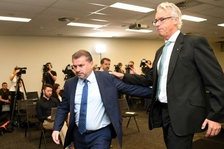 Australia's national football coach Ange Postecoglou leaves a press conference with Football Federation of Australia (FFA) chief David Gallop (R) after announcing his resignation in Sydney on November 22, 2017