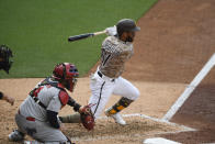 San Diego Padres' Ivan Castillo (61) hits an RBI single during the fourth inning of a baseball game against the St. Louis Cardinals, Sunday, May 16, 2021, in San Diego. (AP Photo/Denis Poroy)