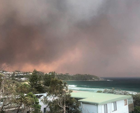 Mollymook Beach, Shoalhaven with fires and smoke in the sky