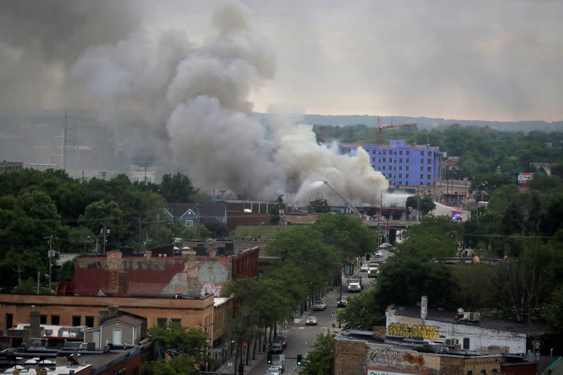 Plumes of smoke rise into the sky in the aftermath of a protest in Minneapolis