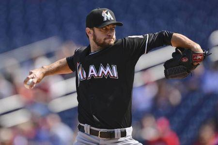 Miami Marlins starting pitcher Jarred Cosart (23) pitches during the first inning Washington Nationals in game one of a baseball doubleheader at Nationals Park. Mandatory Credit: Tommy Gilligan-USA TODAY Sports