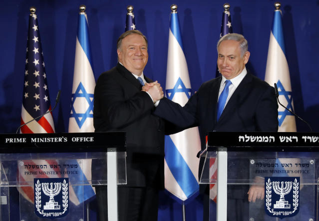 """U.S. Secretary of State Mike Pompeo, left, shakes hands with Israeli Prime Minister Benjamin Netanyahu, during their visit to Netanyahu's official residence in Jerusalem, Thursday March 21, 2019. Netanyahu has praised U.S. President Donald Trump's recognition of its control over the Golan Heights as a holiday """"miracle."""" (Amir Cohen/Pool via AP)"""