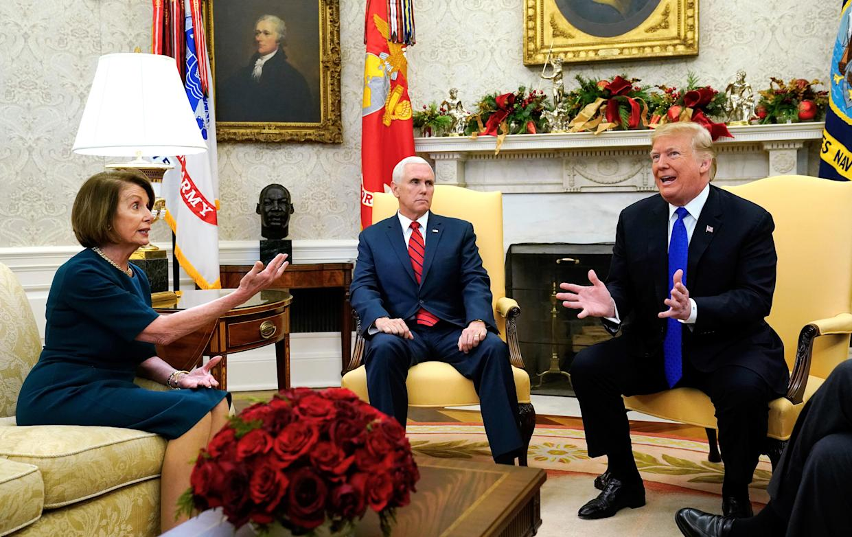 Pelosi and Trump argue as Pence looks on during the heated debate at the White House. (Photo: Kevin Lamarque/Reuters)