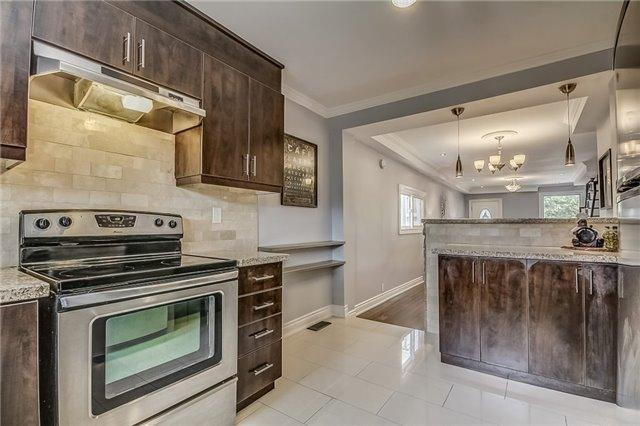 "<p><a rel=""nofollow"">50 Wiley Ave, Toronto, Ont.</a><br /> The kitchen has custom cabinetry and a breakfast bar.<br /> (Photo: Zoocasa) </p>"