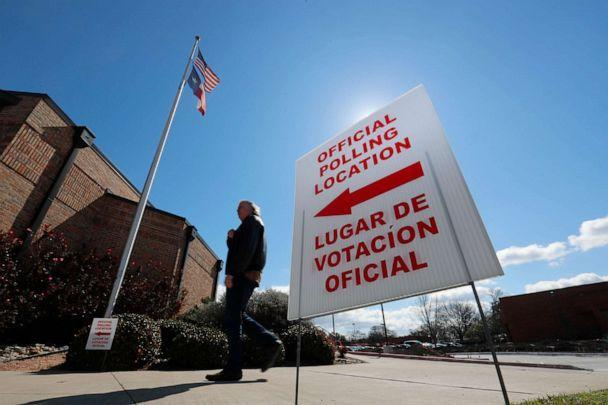 PHOTO: A sign points potential voters to an official polling location in Dallas, Feb. 26, 2020. (Lm Otero/AP, FILE)