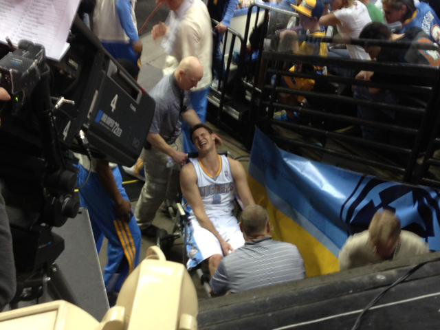Denver Nuggets forward Danilo Gallinari, of Italy, is wheeled off the court after being injured in the second quarter against the Dallas Mavericks in an NBA basketball game in Denver on Thursday, April 4, 2013. (AP Photo/Arni Stapleton)