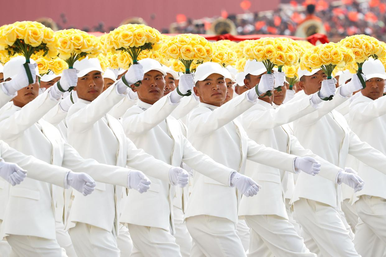 Performers take part in a parade marking the 70th founding anniversary of People's Republic of China, on its National Day in Beijing, China October 1, 2019. (Photo: Thomas Peter/Reuters)