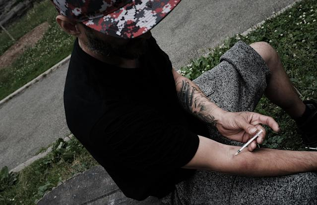 A young man shoots heroin in a park in the South Bronx section of New York City, June 7, 2017. (Photo: Spencer Platt/Getty Images)