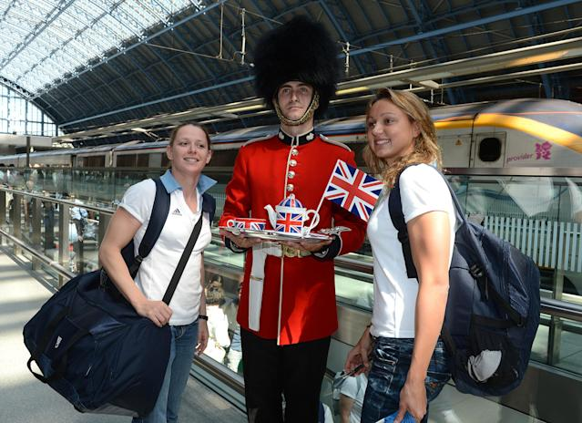 French Olympic swimmers Fanny Babou, left, and Ophelie Etienne, right, receive a very British welcome on arrival at the Eurostar Terminal at London St. Pancras Station ahead of the London 2012 Olympic Games on Tuesday July 24, 2012. (Photo by Mark Allan/AP Images for Eurostar)
